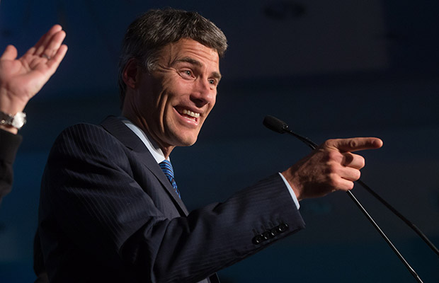 Vancouver Mayor Gregor Robertson gestures while addressing supporters after being elected for a third term during a civic election in Vancouver, B.C., on Saturday November 15, 2014. THE CANADIAN PRESS/Darryl Dyck