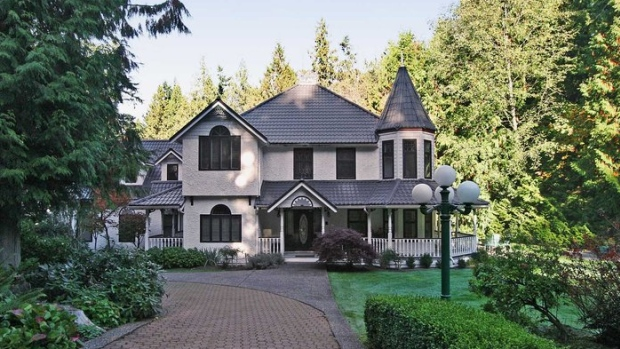This $3.5 million home in Surrey B.C. is one of four Lower Mainland homes a Chinese bank claims are owned by a fugitive who defaulted on a $10 million loan. (Homelife Benchmark Realty Corp.)