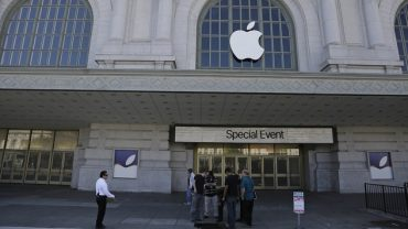 A crew works outside the Bill Graham Civic Auditorium as preparations continue for the Apple new product announcements (AP)