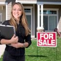woman-agent-realtor-standing-outside-home-for-sale_573x300