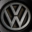 A VW logo sits on a covering under the bonnet of a Volkswagen AG Passat TDI automobile powered by a turbocharged direct injection engine in London, U.K., on Wednesday, Dec. 2, 2015. Volkswagen is grappling with an emissions scandal on three fronts: cheating software installed in about 11 million vehicles worldwide with 1.2-, 1.6- and 2.0-liter engines; irregular carbon dioxide ratings on about 800,000 vehicles in Europe; and questionable emissions software in about 85,000 VW, Audi and Porsche vehicles with 3.0-liter diesel engines in the U.S. Photographer: Miles Willis/Bloomberg via Getty Images
